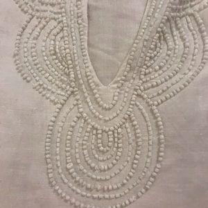 White dress. Beaded neckline also on back.